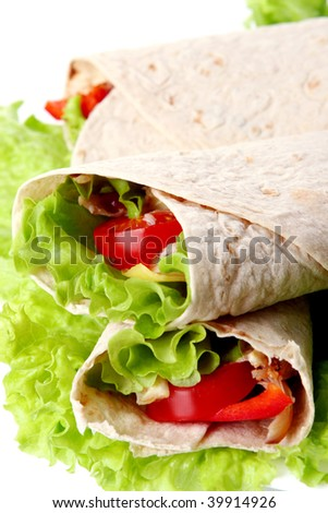 fresh tortilla with vegetables and souce - stock photo
