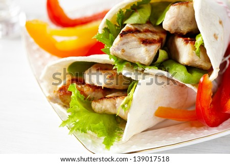 Fresh tortilla wrap with grilled pork and vegetables