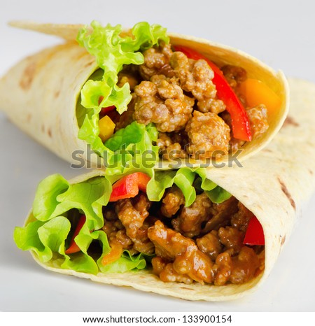 Fresh tortilla wraps with meat and vegetables - stock photo
