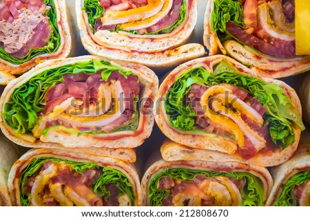 Fresh tortilla wraps with vegetables. Many rolls as background - stock photo