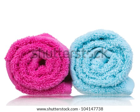 Fresh towel pair rolled-up closeup front view on white background - stock photo