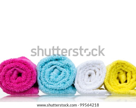 Fresh towels rolled-up front view on white background - stock photo