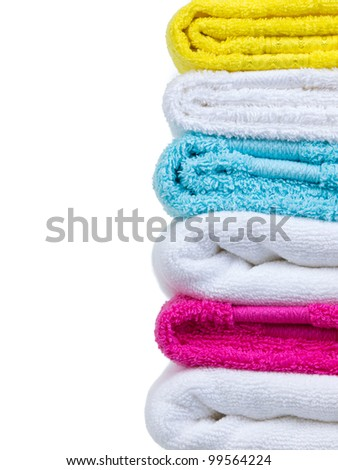 Fresh towels stack closeup side view on white background - stock photo
