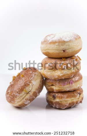 Fresh tower of polish donuts with jam, chocolate and icing isolated on white background - stock photo