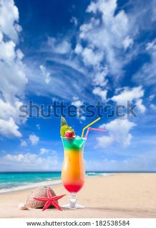 Fresh tropical cocktail on beautiful sunny beach - stock photo