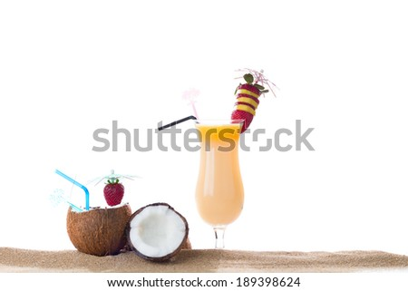 Fresh tropical cocktail on the sand - stock photo
