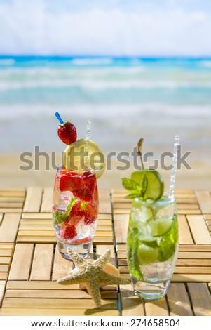 Fresh tropical cocktails on beautiful sunny beach - stock photo