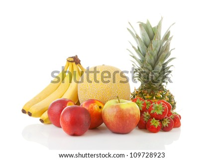Fresh tropical fruit over white background