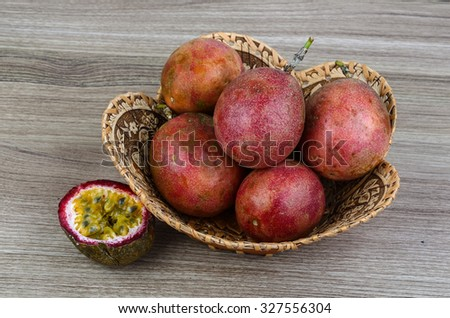 Fresh tropical fruit - Passionfruit - in the basket o wood background