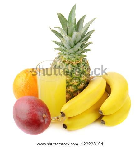 fresh tropical fruits: banana, mango,  pineapple isolated on white background with juice - stock photo