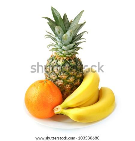 fresh tropical fruits: banana, orange,  pineapple isolated on white background - stock photo
