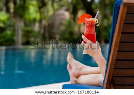 fresh tropical juice cocktail served pool side in Belize - stock photo