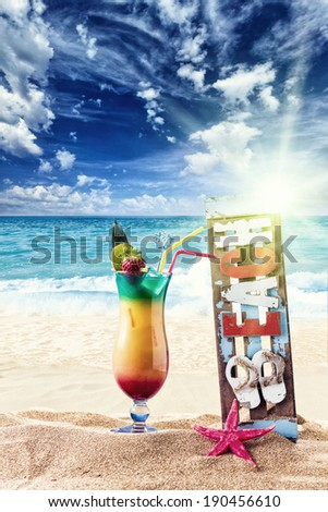 Fresh tropical sex on the beach cocktail on beautiful sunny beach - stock photo