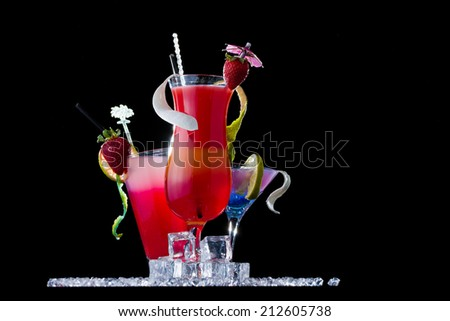 Fresh tropical strawberry cocktail on black background - stock photo