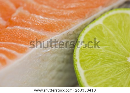 Fresh trout with lime close up - stock photo