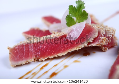 Fresh tuna meat sliced at white plate - stock photo