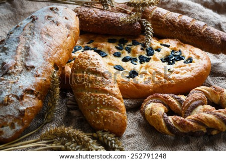 Fresh Turkish bread with black olives and variety of bread - stock photo