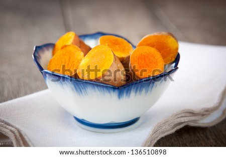 Fresh turmeric is used in cooking, in herbal medicine as an anti-inflammatory and in skin care - stock photo
