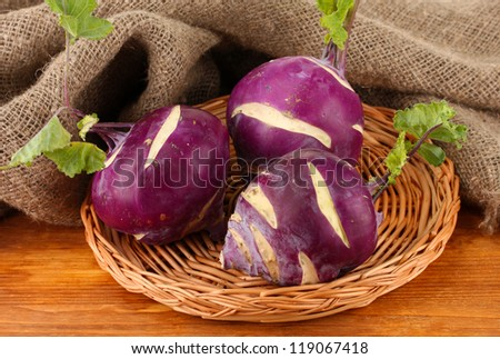 Fresh turnip on wooden background