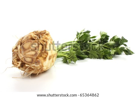Fresh turnip-rooted celery against a white background