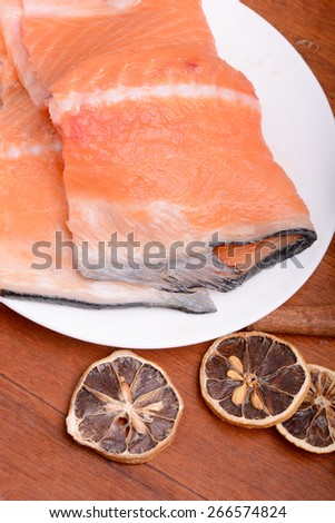 Fresh uncooked red fish fillet slices - stock photo