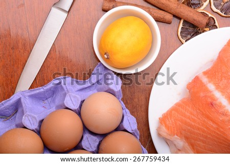 Fresh uncooked red fish fillet slices and egg - stock photo