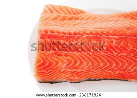 fresh uncooked salmon fillet on white plate - stock photo