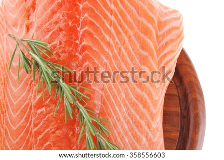 fresh uncooked salmon fillet with rosemary on wood