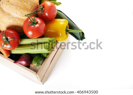 fresh vegatables in crate isolated on white background/ top view - stock photo