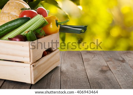 fresh vegatables in crate on wooden table/ healthy food  - stock photo
