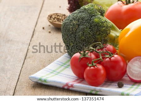 fresh vegetable and food ingredients on wood background