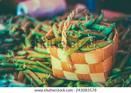 Fresh Vegetable Organic Green Beans In Wicker Basket. Production Of Local Food Market. Toned Instant Photo - stock photo