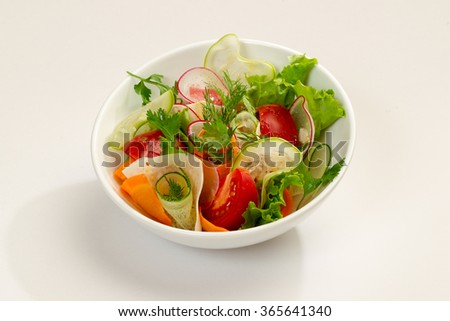 fresh vegetable salad and cheese plate isolated on white background. - stock photo