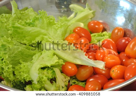 Fresh vegetable salad and tomatoes served raw to maintain freshness