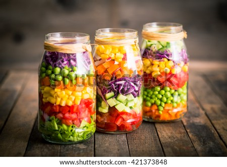 Fresh vegetable salad in a mason jar - stock photo