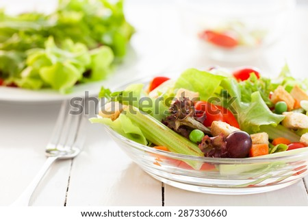 fresh vegetable salad in glass bowl - stock photo