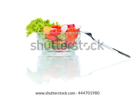 fresh vegetable salad in glass bowl with fork isolated on white - stock photo
