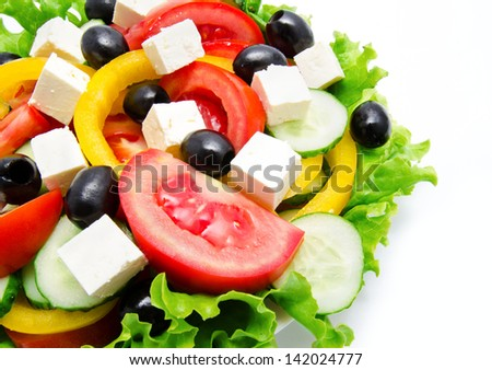 Fresh vegetable salad isolated on a white