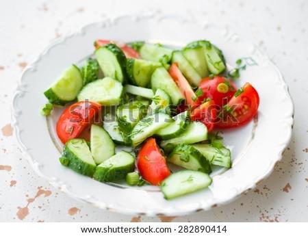 Fresh Vegetable Salad on White Plate Healthy Vegan Food - stock photo