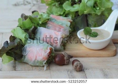 Fresh vegetable salad roll with salad dressing