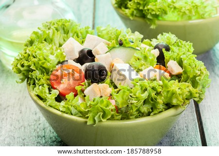 Fresh vegetable salad with cheese and olives - stock photo