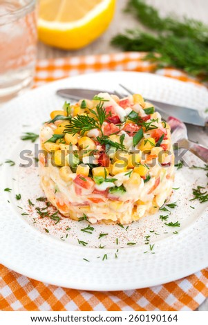 Fresh vegetable salad with corn, pepper, crab, cucumber, eggs and mayonnaise - stock photo
