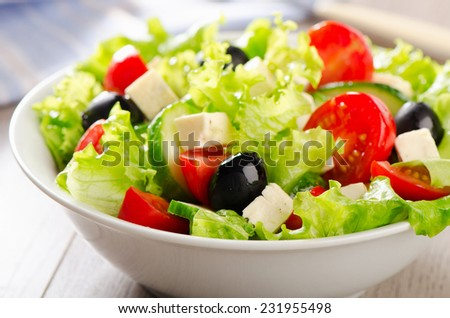 Fresh Vegetable salad with feta . Selective focus - stock photo
