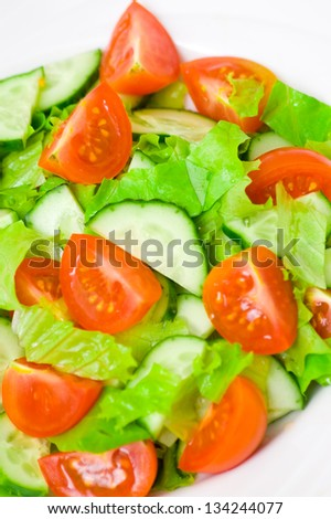 fresh vegetable salad with lettuce, tomato and cucumber