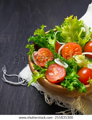 Fresh vegetable salad with tomato, endive and onion. Selective focus.  - stock photo