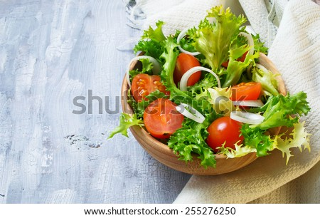 Fresh vegetable salad with tomato, endive and onion. Selective focus. Space for text - stock photo