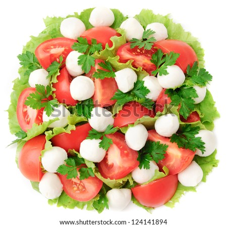 fresh vegetable salad with tomatoes, bell pepper, cheese mozzarella and greens - stock photo