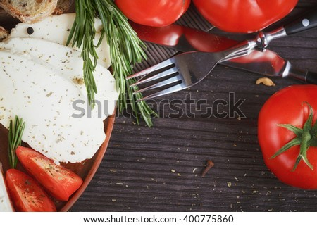 Fresh vegetable salad with tomatoes, cucumbers and onions. Served with ...