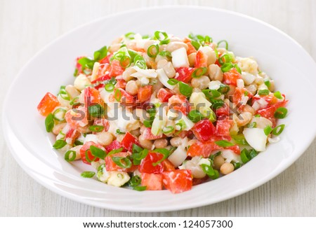 fresh vegetable salad with white beans, red pepper, tomato, egg and green onions - stock photo