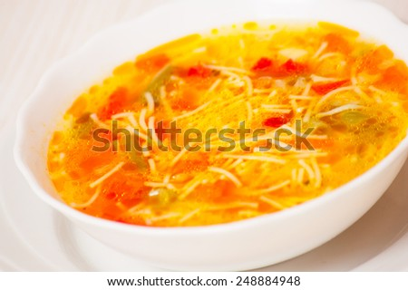 Fresh vegetable soup with noodles - stock photo